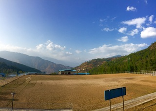 View of Bhutanese fields and mountains