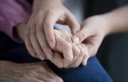 Stock photo of holding hands with elderly person.