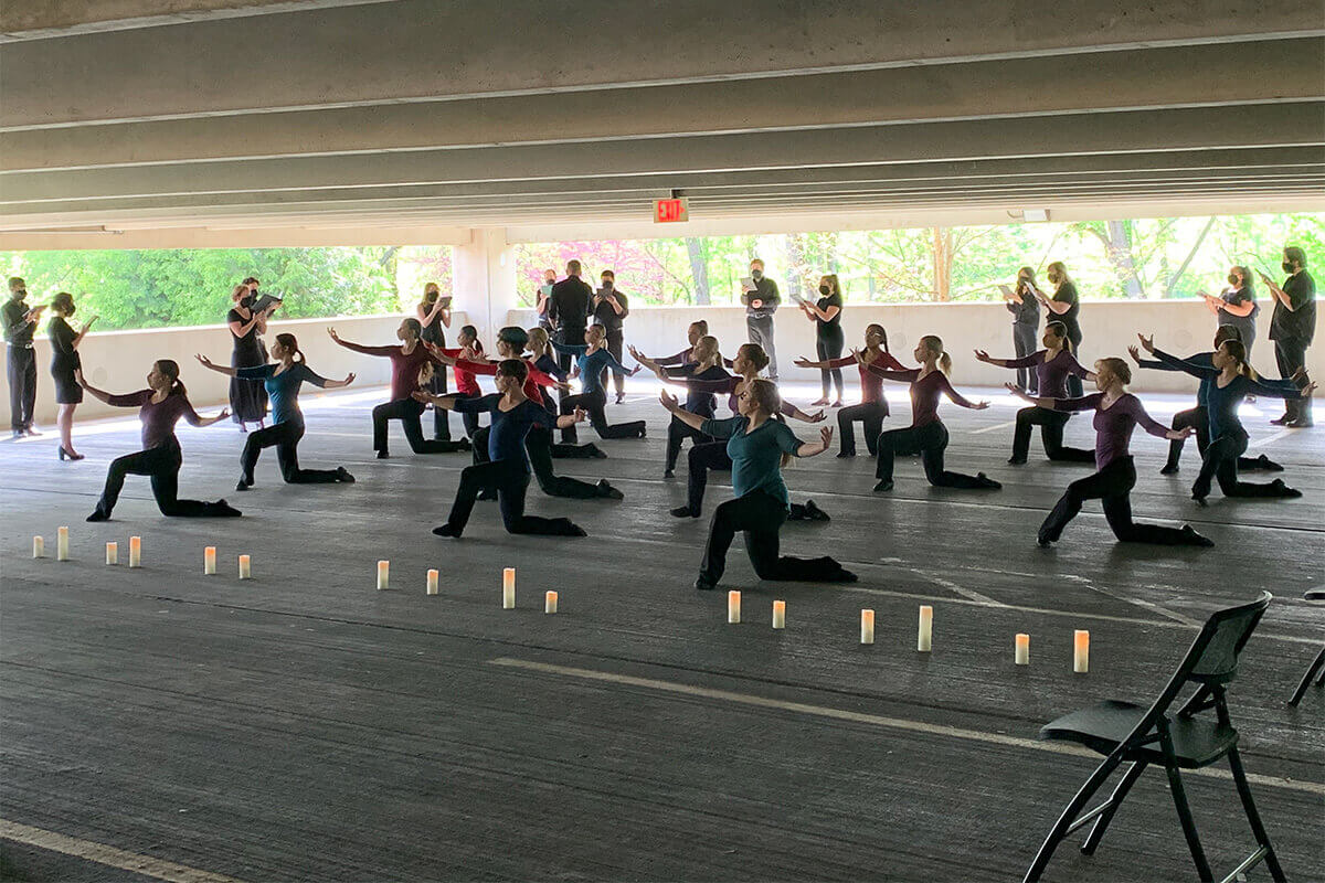 Choirs and Dance Ensemble Collaborate on Outdoor Performance in Parking Garage